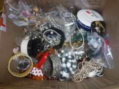 A box containing a large quantity of various mixed costume jewellery, jewellery boxes, dome top