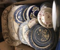 Four boxes of sundry china and glass to include transfer decorated serving platters, decanters,