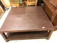 A modern faux crocodile skin covered coffee table with plain quartered top on square supports united