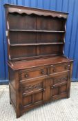 A modern oak dresser in the circa 1700 manner, the two tier boarded plate rack over two drawers