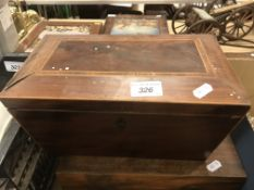 A 19th Century mahogany and rosewood banded and satin wood strung tea caddy of sarcophagus form, the