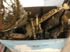 A box containing assorted metal wares to include candlesticks, fire crane, plated basket, knife