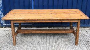 A French style pine farmhouse kitchen table, the plank top with cleated ends on rectangular supports