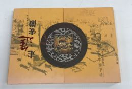 A box containing a collection of ten albums of Chinese stamps, mainly issued by The China National