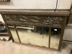 A Victorian gilt framed overmantel mirror with relief work frieze decorated with Classical scene