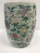 A 19th Century Chinese celadon glazed famile rose garden seat of barrel form, the top and sides with