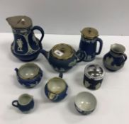A collection of seven pieces of Wedgwood blue Jasper ware including teapot, water jug, cream jug,