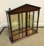A Victorian mahogany glazed hanging display cabinet with architectural dentil cornice over two doors