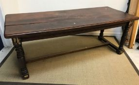A modern mahogany refectory style dining table, the rectangular top on turned supports to block