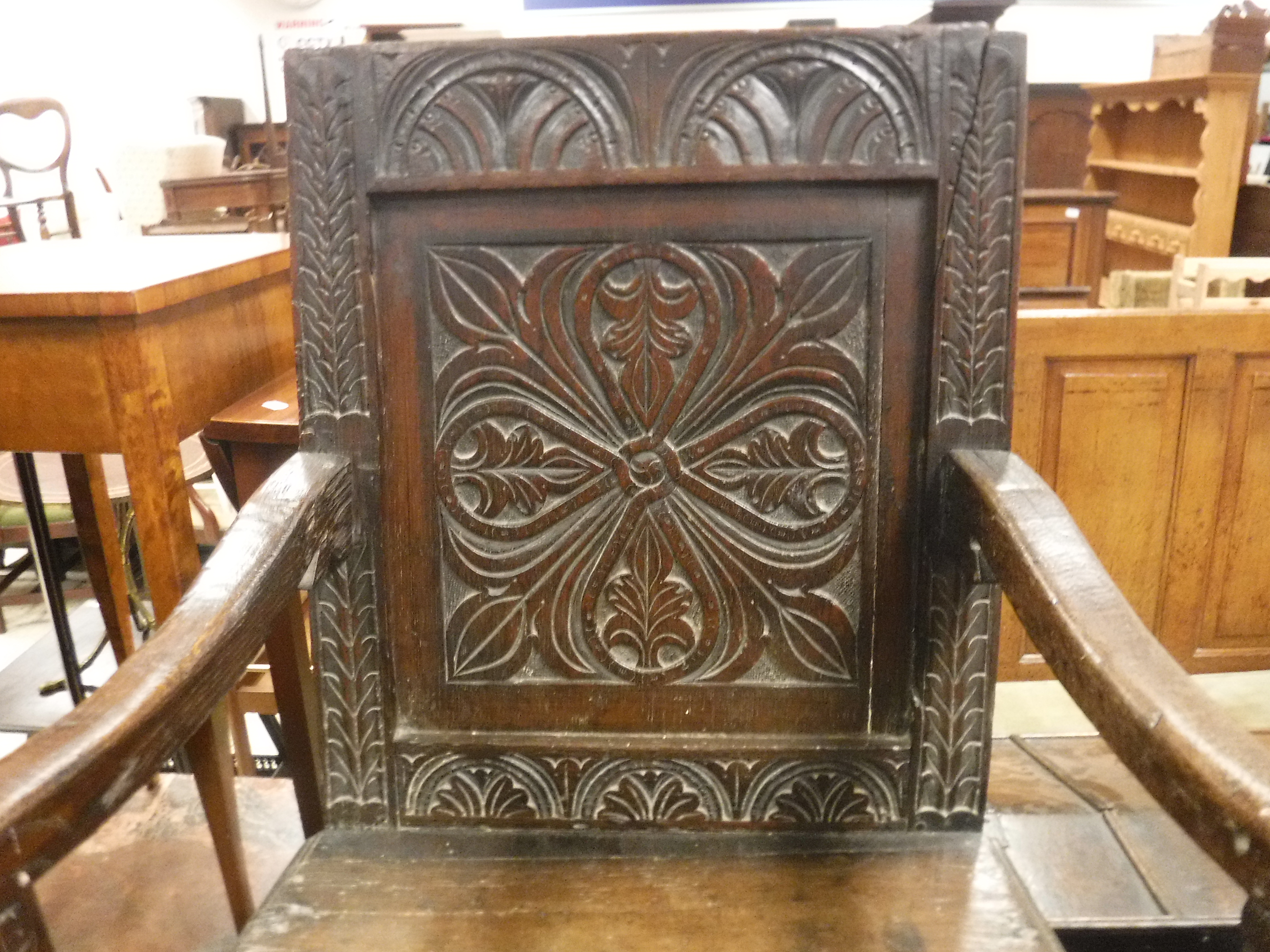 A 17th Century oak Wainscott type chair, the lunette carved top rail over a foliate medallion - Image 4 of 24