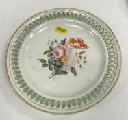 A pair of 19th Century Meissen ribbon plates, the centre fields decorated with floral sprays, bear