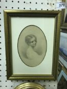 """A 19th Century pencil drawing of """"Young child"""", set in oval mount, together with a further similar"""