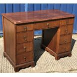 A mahogany kneehole desk in the Georgian style, the top with applied gadrooned edge over three