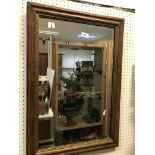 An 18th Century walnut and gilt framed rectangular wall mirror of plain form with Vauxhall plate, 50