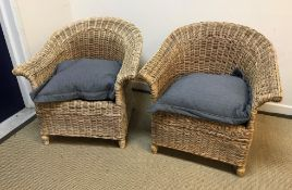 A pair of modern canework conservatory scroll arm chairs on baluster front legs, 82 cm wide x 82