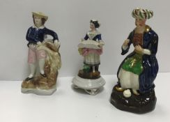 A 19th Century Staffordshire figure of a Turk, with hollow base, 19.5 cm high, together a 19th