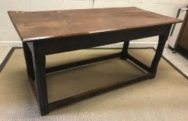 An 18th Century and later oak refectory style table, the plank top with chamfered edge over a