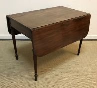 An early 19th Century mahogany drop-leaf Pembroke table on slender turned and reeded tapering legs