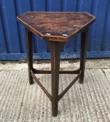 A 19th Century elm and oak cricket table, the triangular top with canted corners and applied beading