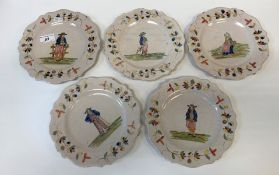 A set of five Quimper pottery tin glazed plates with figural decoration, together with a matching
