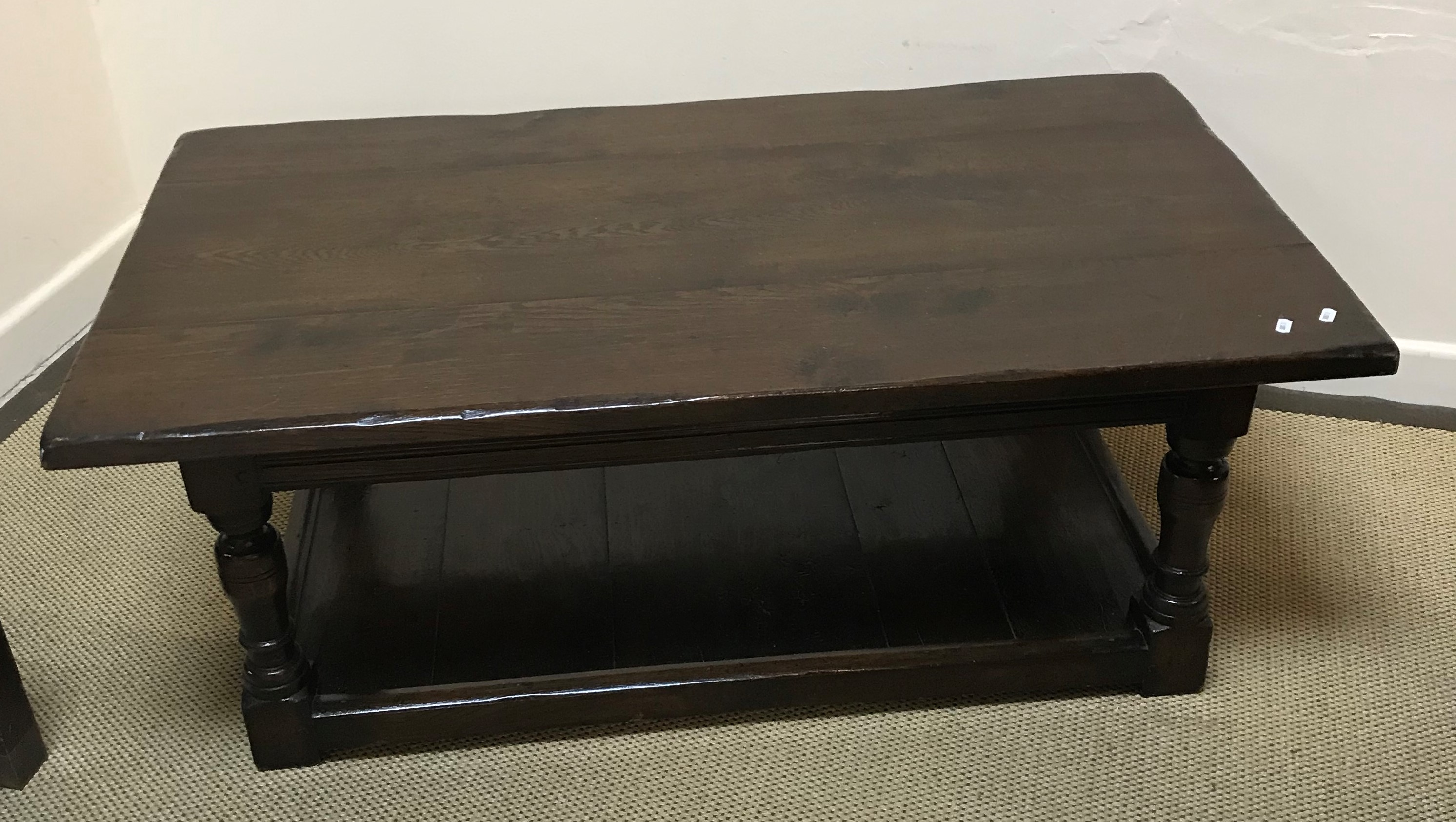 An oak coffee table, the three plank top above a frieze drawer on end pillar supports to splayed - Image 2 of 3