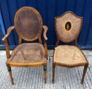 A late 19th Century Adam Revival satinwood and painted elbow chair with caned back and seat on
