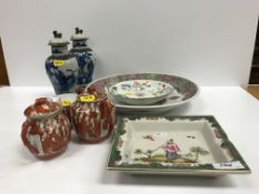 A collection of Chinese and Japanese porcelain to include a famille rose circular dish decorated