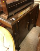 A 1930's oak sideboard, oak plate rack, mahogany chest of two drawers over two cupboard doors,