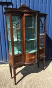 An Edwardian mahogany and inlaid display cabinet with barber pole stringing throughout, the