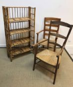 A Victorian stained beech rush seat ladder back elbow chair, 54 cm wide x 56 cm deep x 107 cm