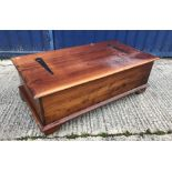 A modern teak living room chest with rising lid over a bank of twelve small drawers raised on