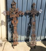 Two late 19th/early 20th Century wrought iron crosses 143 cm and 146 cm