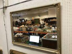 A modern gilt framed rectangular wall mirror, 100 cm x 69.5 cm