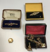 A collection of 9 carat gold jewellery including filigree work decorated brooch, circular locket,