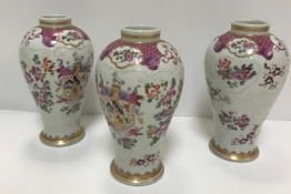 A set of three Samson of Paris urn-shaped vases decorated with armorials and floral sprays, 15 cm