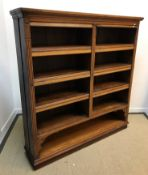 A Victorian oak open bookcase with two banks of adjustable shelving each with an upper fall flap