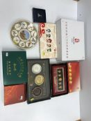 A collection of Beijing 2008 Olympics memorabilia / ephemera including a Friendlies silver plated