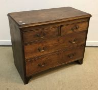 A 19th Century elm chest, the plain top with applied moulded edge over two short and two long