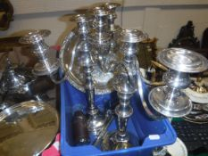 A pair of EPNS three branch two light table candelabra, 41.5 cm high, a plated salver, 28 cm wide,