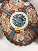 A collection of Chinese and Japanese porcelain including a Daoguang polychrome decorated shaped dish