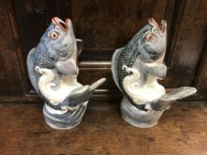 A pair of 18th Century Japanese Arita blue and white and oxide red over-glazed decorated carp