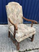 An early 20th Century Swiss oak framed hall chair in the 18th Century manner, the upholstered back