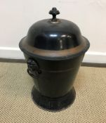 A 19th Century toleware coal box, black painted and gilt banded, the domed top with mushroom finial,