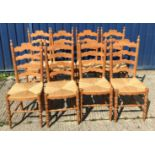 A set of eight modern pine rush seat ladder back dining chairs in the 19th Century manner, 42 cm