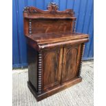 A Victorian rosewood chiffonier with raised shelved back on bobbin turned supports over a cushion