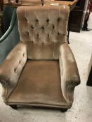 A Victorian buttoned upholstered scroll arm chair on turned front legs to castors