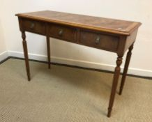A burr elm hall table in the Regency style, the inlaid and cross-banded top with moulded edge over