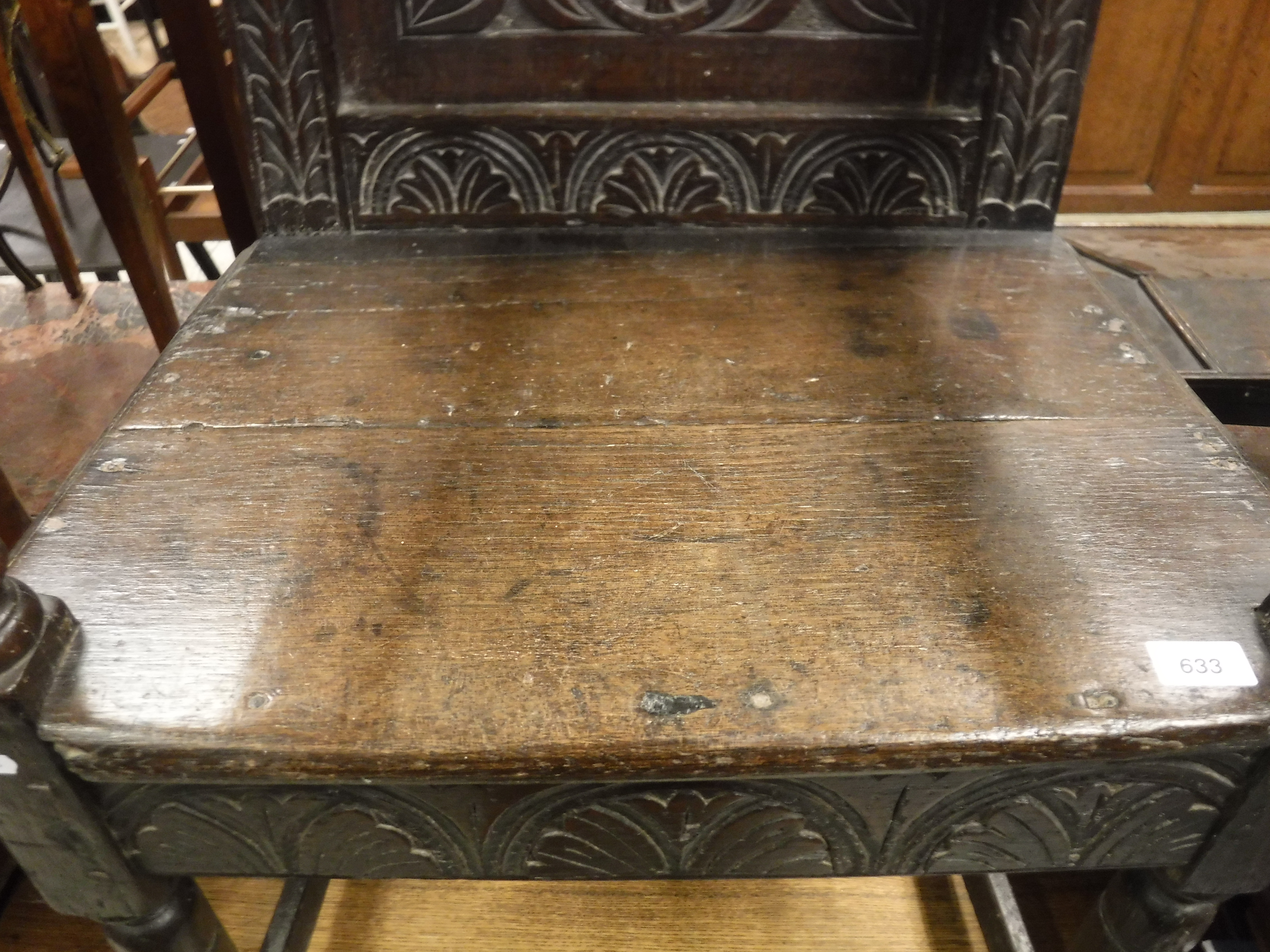 A 17th Century oak Wainscott type chair, the lunette carved top rail over a foliate medallion - Image 7 of 24
