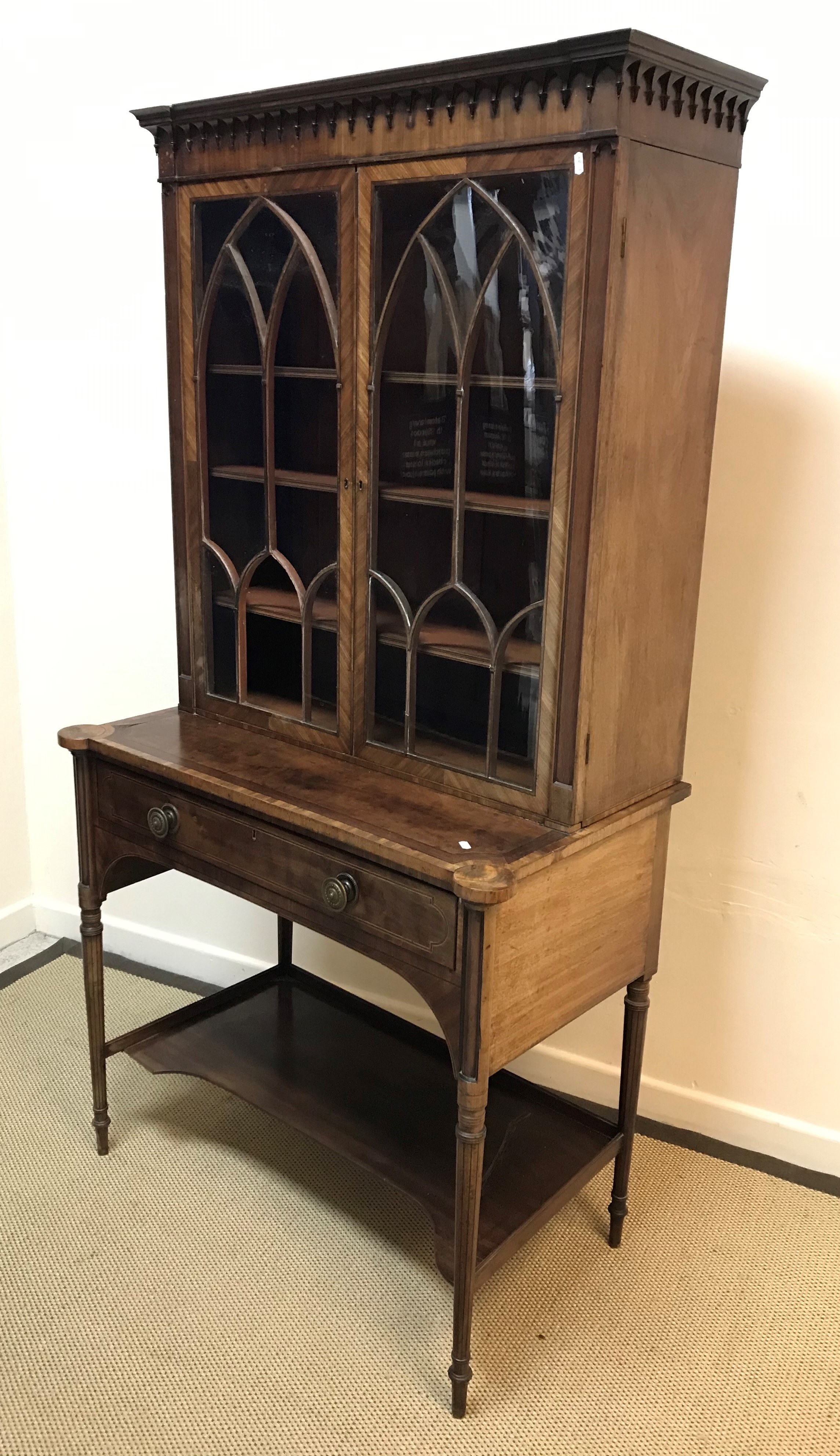 A 19th Century mahogany and inlaid secretaire bookcase, the upper section with decorative cornice