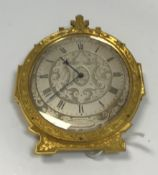 A 19th Century Gothic Revival style engraved brass cased bedside clock in the manner of Thomas Cole,